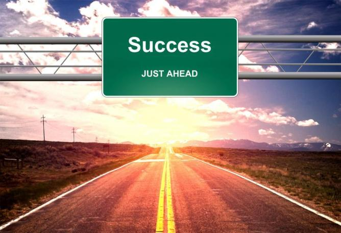 success-just-ahead-road-sign--life-success-concept