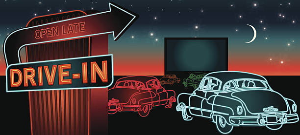 Classic Drive-In Theatre with cars and neon sign